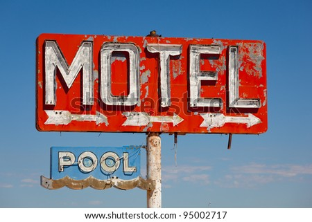 Red, vintage, neon motel sign on blue sky