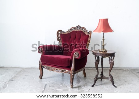Red vintage sofa and lamp on white wall.