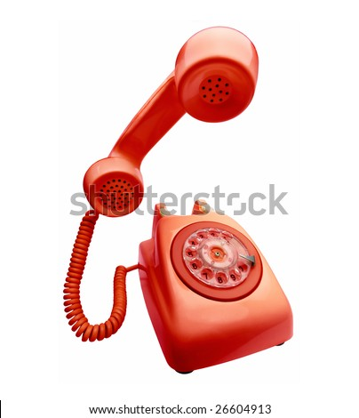 Red vintage telephone with the handset  on first plane