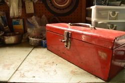 Red vintage toolbox on a table