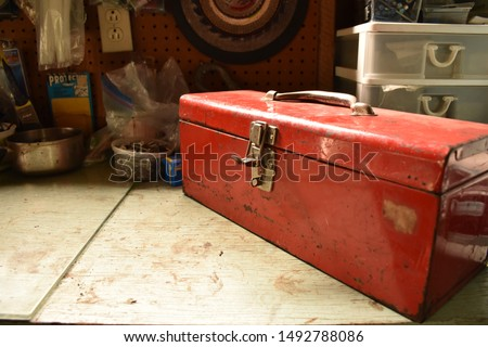 Red vintage toolbox on a table #1492788086