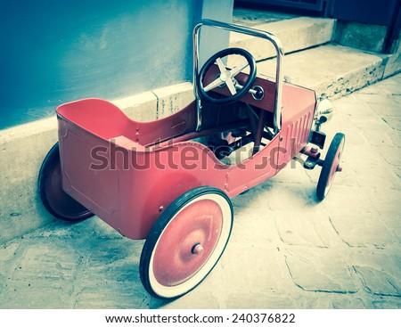 red vintage toy car near...