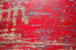 Red vintage wooden table background with chipped paint