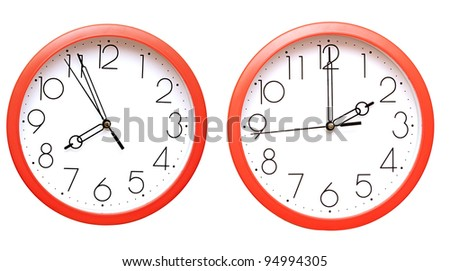 red wall clocks on white