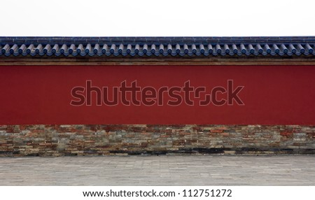 Red wall with blue roof tiles around complex in China