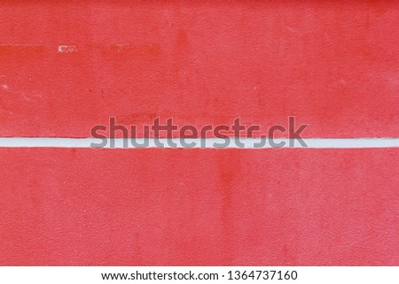 Red wall with white groove.