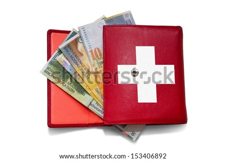 Red wallet with swiss franc banknotes