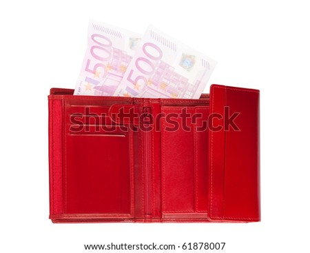 Red wallet with two disappearing five-hundred-euro banknotes isolated over a white background.