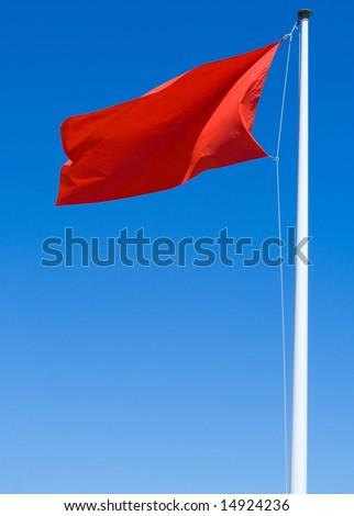 Red warning flag at the beach