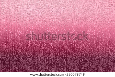 Red Water Droplets. Water condensation forms a random pattern of circular water droplets of varying sizes. Background fades from pink to dark red.