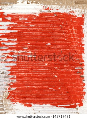 red watercolor background on cardboard