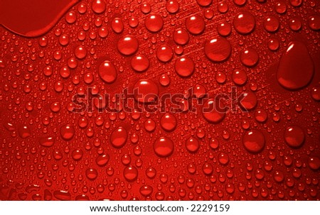 red waterdrops from above - stock photo