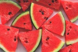 Red watermelon triangular piece on white blackground