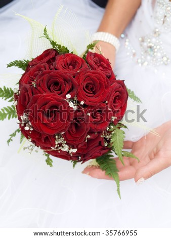 stock photo red wedding bouquet at bride 39s hands