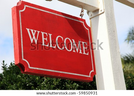 Red welcome sign of a hotel or restaurant.