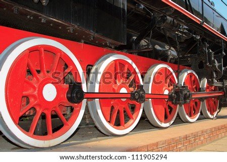 Red wheels of the old express steam train - stock photo
