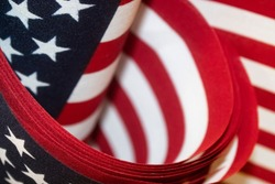 Red white and blue American flags background - selective focus