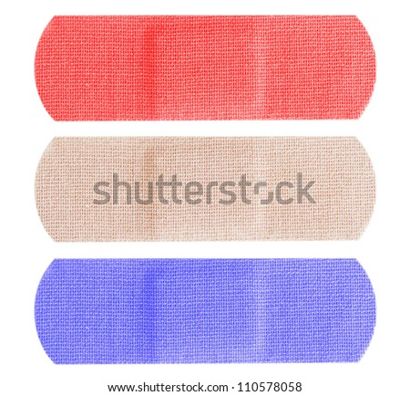 Red, white and blue bandages or bandaids isolated on white background.