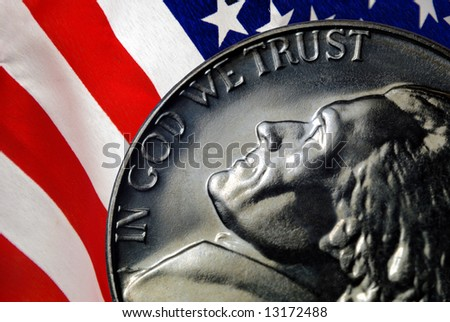 Red, White, and Blue From American Flag Reflected in God We Trust Motto on Vintage, Retro, 1967 United States Nickel - stock photo
