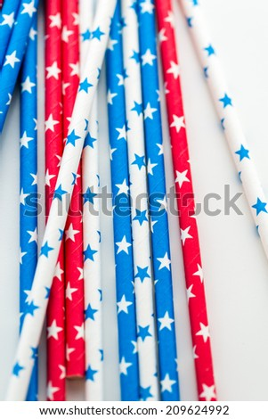 red, white and blue paper straws with stars.