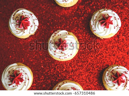 Red, White, and Blue Patriotic Cupcake with red sparkle background #657310486