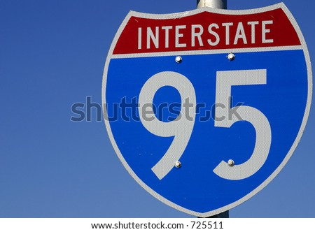 Red, white and blue sign directing travelers toward Interstate 95 in Central Florida, USA - stock photo