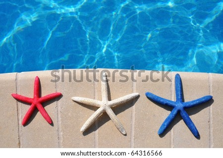 Red, White and Blue Starfish sitting by swimming pool. Room for your text