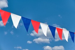 Red white and blue triangular bunting on sky background