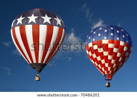 Red White & Blue Hot Air Balloons Against a Blue Sky
