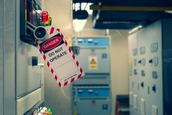 Red, white Lock out & Tag out for Lock station,machine - specific or switch gear roomd evices and safety first point, Cyber security or safety industrial concept.