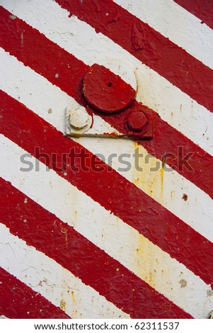 red white pattern closeup, construction site machinery