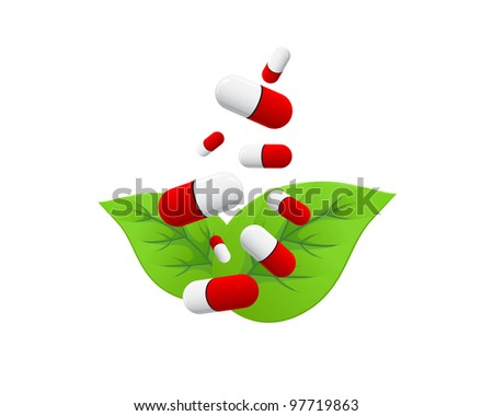 Red white pills falling on green leaves on white background