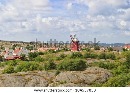 Red windmill on a hill in the Swedish west coast