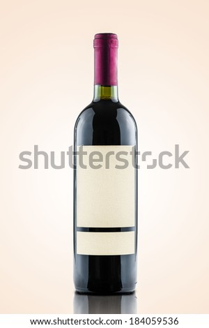 red wine and a bottle isolated over a warm gradient background - white label