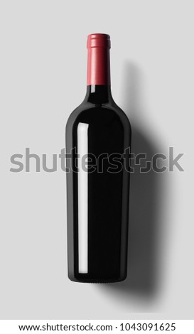 red wine and a bottle isolated over white background.Wine bottle for your logo and design.Glass wine bottle. #1043091625