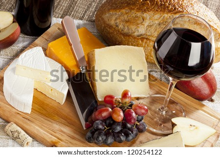 Red Wine And Assorted Cheese Plate with fruit