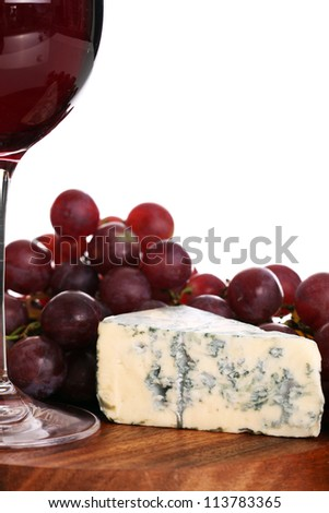 Red wine and blue cheese over white background