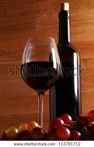 Red wine and blue cheese over wooden surface