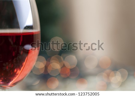Red wine and Christmas light reflection with soft focus