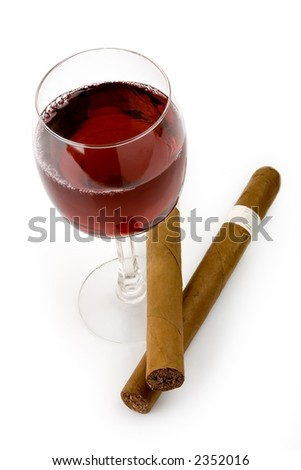 Red wine and cigars isolated in white background