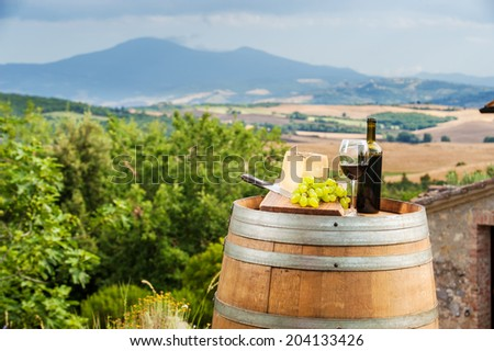 Red wine and grapes with pecorino cheese the Tuscan, Italy