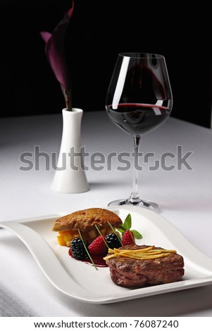 Red wine and meat dish decorated calla lily