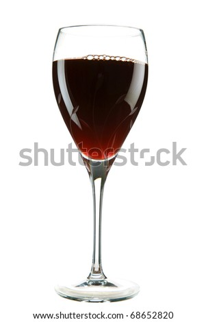 red wine being poured into a cut crystal wine glass    isolated on white with room for your text