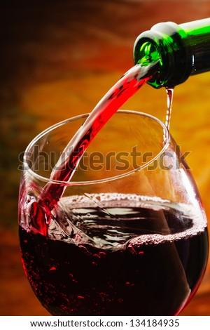 Red wine being poured into wine glass #134184935