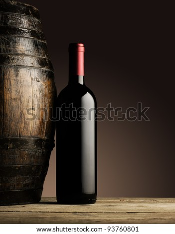 red wine bottle and wooden barrel