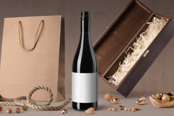 Red wine bottle mockup on wooden background, with blank label to place your design