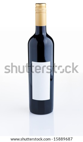 Red wine bottle with empty label over white background