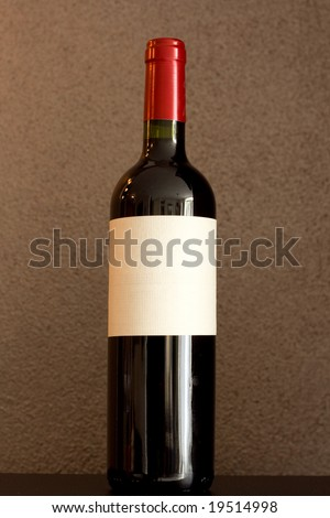 Red wine bottle with empty label to put your text on