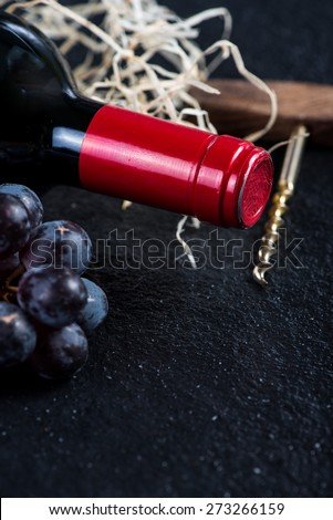 Red wine bottle with grapes and corkscrew,food border background