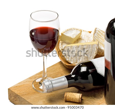 Red wine, Brie and Camembert  on the wood surface, studio shot, isolated, white background